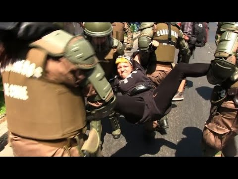 Police arrest protesters after Pope Francis' mass in Santiago