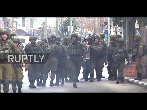 State of Palestine: Israeli soldiers blindfold detained man, push Press away