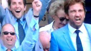 Bradley Cooper and Gerard Butler celebrate Andy Murray's win at Wimbledon in the mens finals