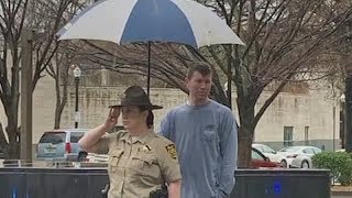 Act of kindness: Good Samaritan holds umbrella over deputy at funeral