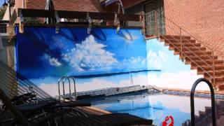 Gambar cover MURAL ARTÍSTICO DE PLAYA EN MURO PISCINA / ARTISTIC BEACH MURAL IN A SWIMMING POOL WALL