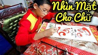 Nổi da gà với cậu bé thư pháp Trần Thiên Phú nhìn mặt cho chữ