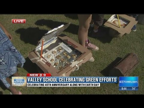 Smart cookies at Awakening Seed School show off solar ovens