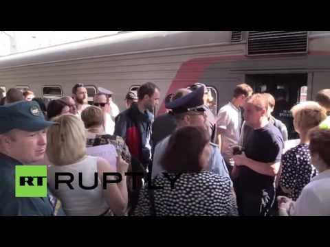 Russia: Survivors from Lake Syamozero summer camp arrive in Moscow
