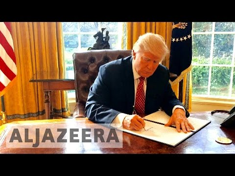 Trump signs new immigration order excluding Iraq