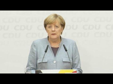 Merkel says she's open to wide coalition talks