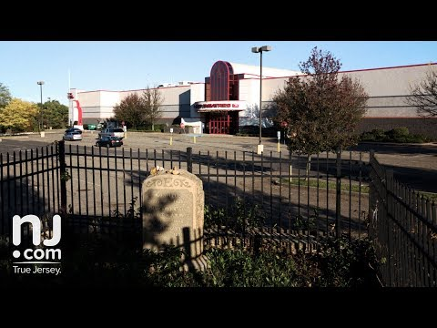 Why is Mary Ellis buried in a movie theater parking lot?
