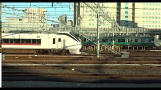 相鉄JR直通線の試運転のため埼京線E233系が常磐線特急E657系の隣に停泊している高輪ゲートウェイ駅を通過した山手線外回り新ルートの車窓