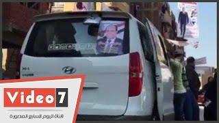 """بالفيديو.. أنصار""""نجيب جبرائيل"""" يروجون دعايته الانتخابية أمام لجان الزاوية الحمراء"""