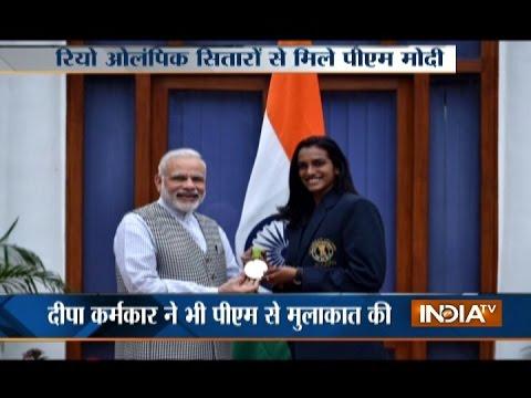 PM Narendra Modi meets PV Sindhu, Sakshi, Dipa