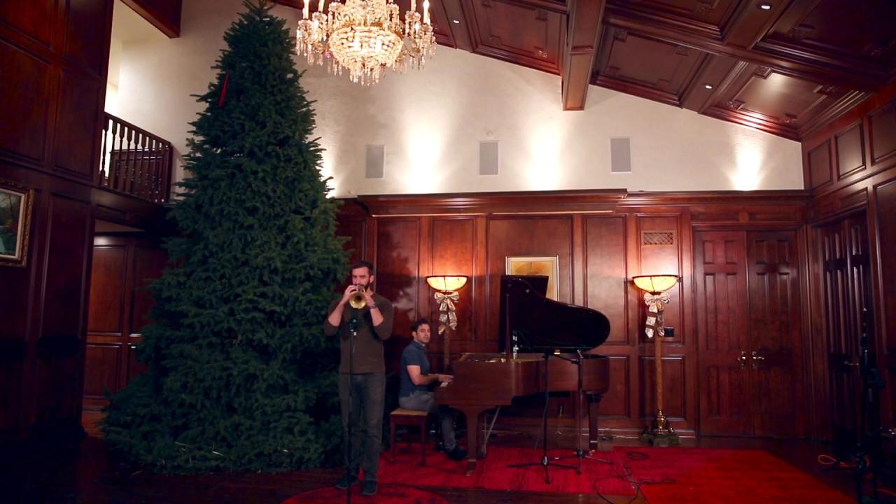 "Playing ""O Christmas Tree"" Under A 16 Foot Christmas Tree"