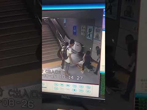 The Terrifying Moment a Woman Falls into an Escalator Well in Shenzhen