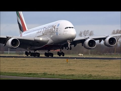 Emirates A380 Windy Landing At Schiphol Amsterdam With  Reverse Thrust Spray