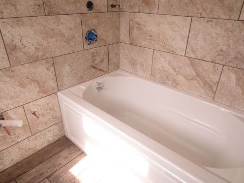 Time lapse Large format tile tub area and wood look plank tile floor