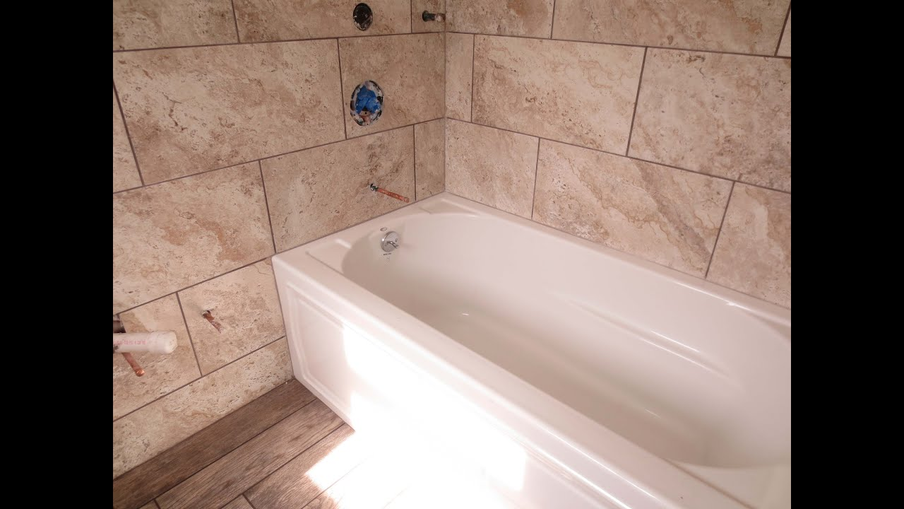Beau Time Lapse Large Format Tile Tub Area And Wood Look Plank Tile Floor
