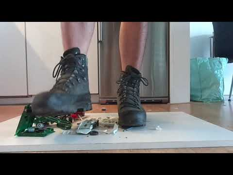 Lowa Hiking boots stomp and destroy some toy model car trailers
