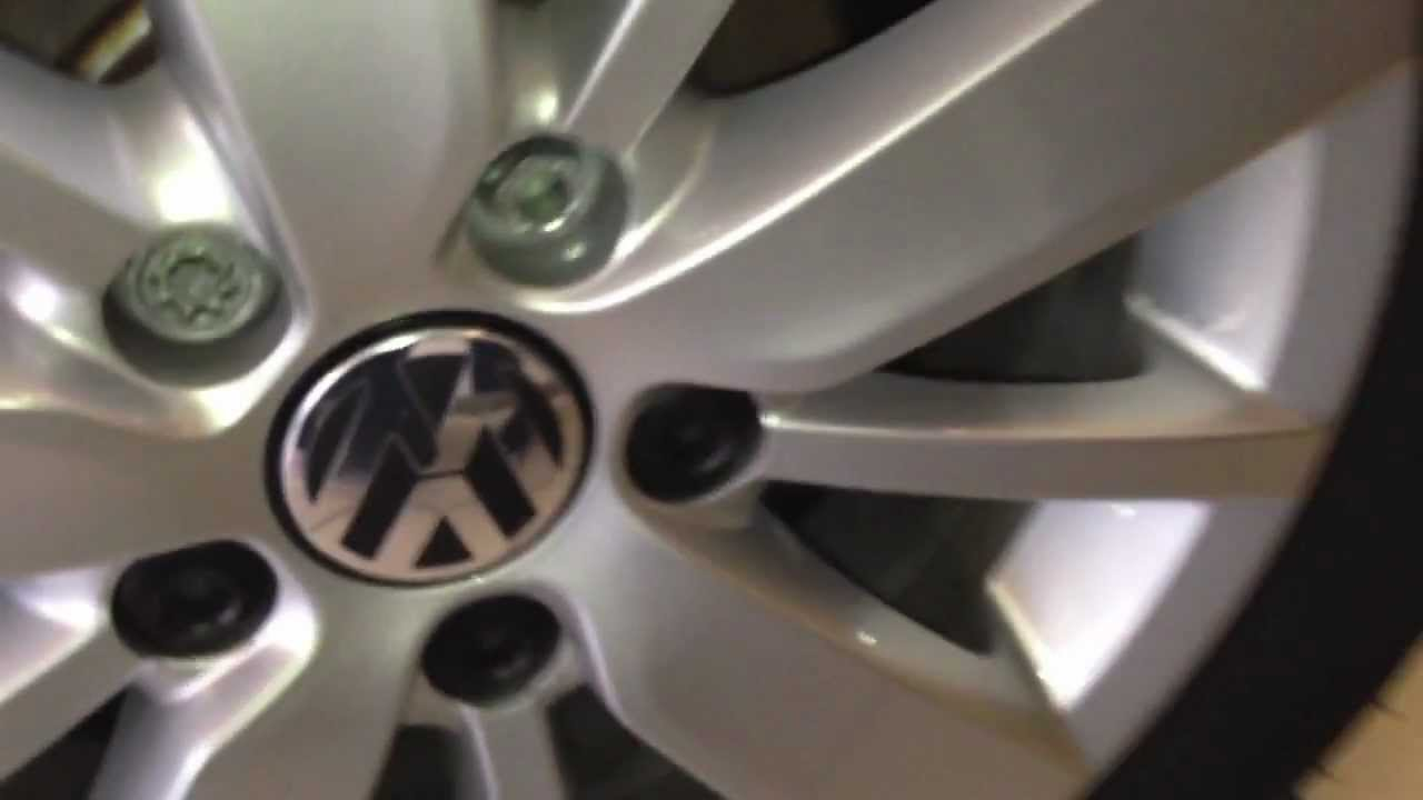 VW wheel nut/bolt cover removal or replacement - YouTube
