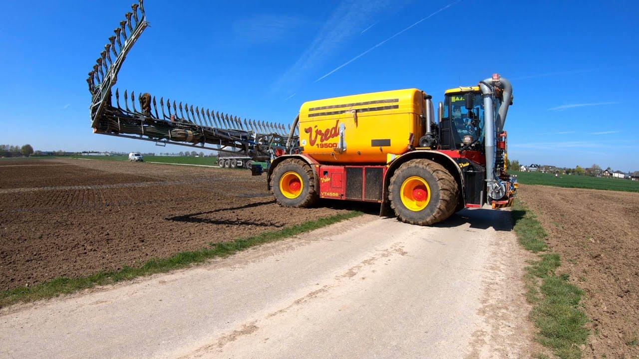 Vredo VT 4556 bei der Gülleausbringung vor Mais + Fendt beim Grubern und div. LKW als Zubringer