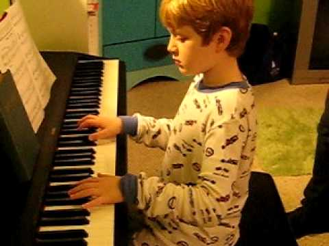 8 year old playing Christmas Time Is Here
