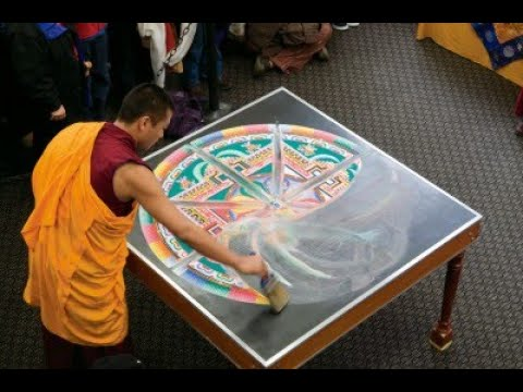 Buddhist Monks Display Power of Love and Peace: Insane woman attacks their artwork