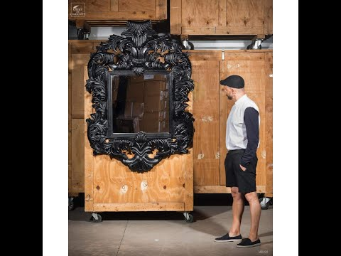 Heavily carved mirror