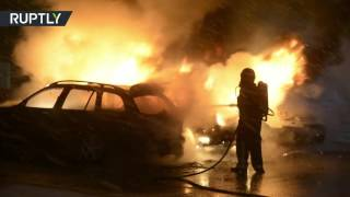 Firefighters battle to extinguish car fires in Stockholm suburb