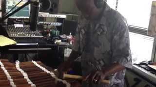 Balla Kouyate playing the balafon in the studio with Egun Omode.