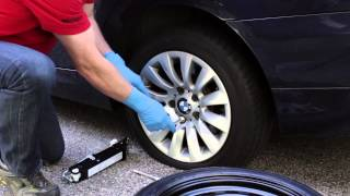 changing a flat tire on a bmw or mini bavauto space saver spare tire kit