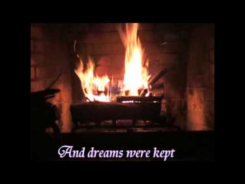 Listening to Try to Remember with lyrics in front of a fireplace