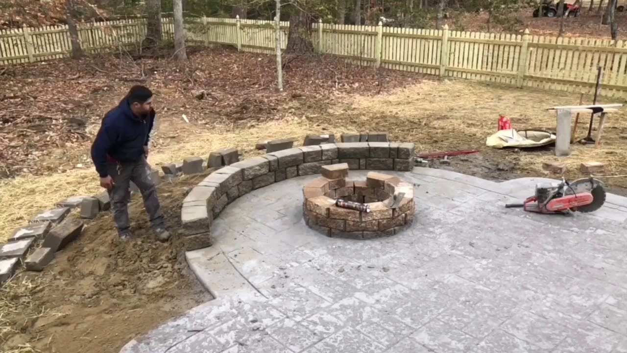 Stamped concrete patio w/ fire pit and sitting wall - YouTube