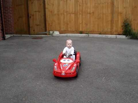 Amazing 7 month old baby driving car