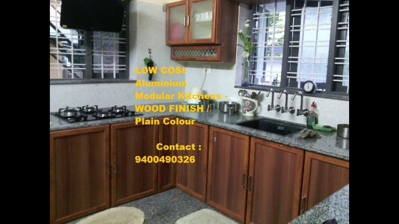 Cost For Kitchen Cabinets Range Hood Thrissur Low Interiors Ph 9400490326
