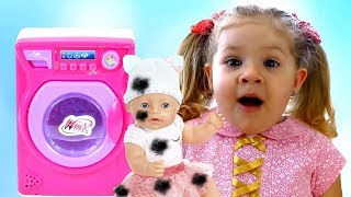 Diana pretend plays being a mother to Baby Born Dolls & toy washing machine