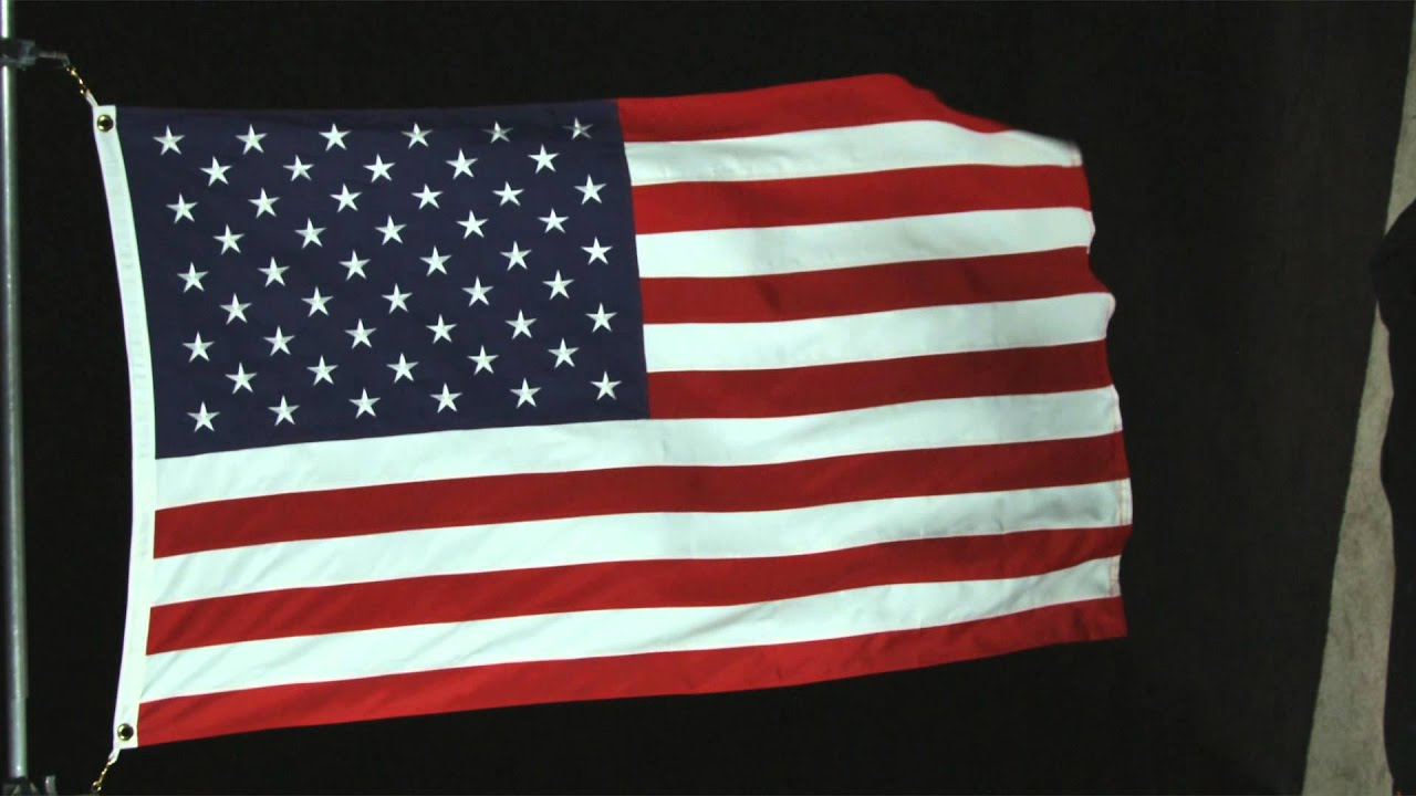 American flag waving in the wind with black background ...