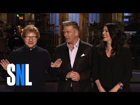 Alec Baldwin Is Not A Fan Of Ed Sheeran's Trump Impression In The Latest Promos For 'SNL'
