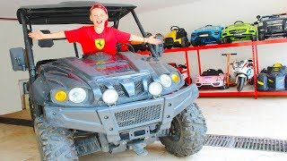 Little driver Ali rides on cars - Huge Toy Car Garage
