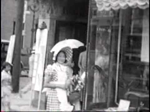 1930s film clip of parasol girls walking in the Ginza