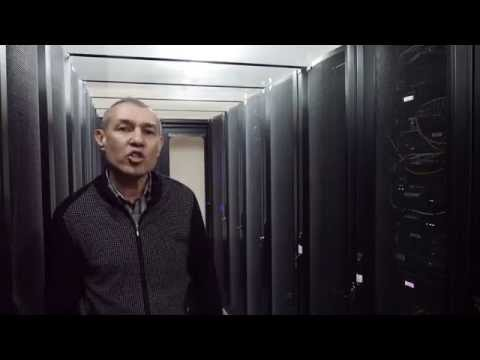 Cloudman demonstrating Webit Telecom server rack cabinets in his Data Center ahost.kz