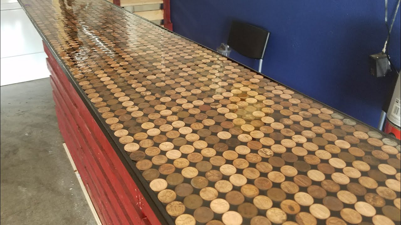 Putting the Epoxy coat on our penny bar top - YouTube