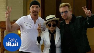 Yoko Ono joins U2 to unveil John Lennon memorial tapestry - Daily Mail