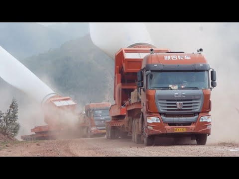 C&C trucks carrying wind turbine blades to the mountaintop