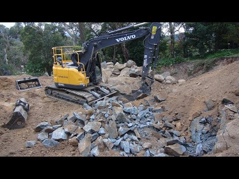 Blasting hard rock in a site cut at Upper Ferntree Gully