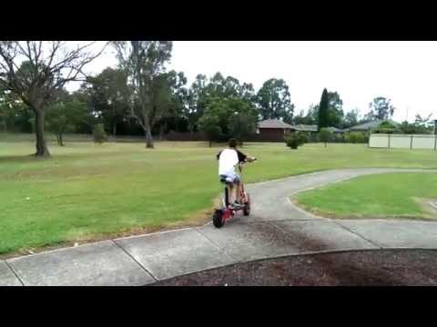 Riding a Bullet RPZ1600 electric scooter at the park