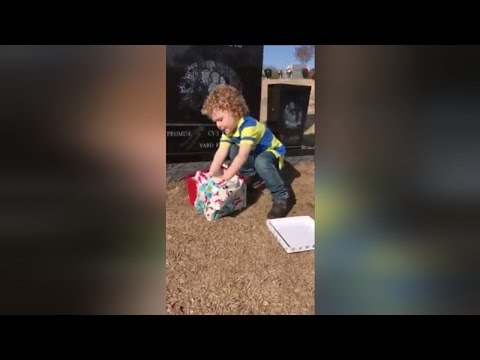 Watch 2-Year-Old Boy Run To Open Christmas Gift Left On Dad's Gravesite