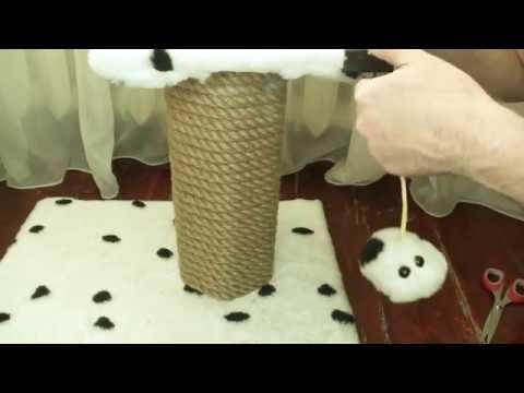 Вопрос: Как научить подростающую кошку точить ногти в своет домике о стойку?