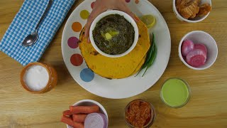 Woman hands placing a bowl of freshly prepared Sarson ka saag in a ceramic plate