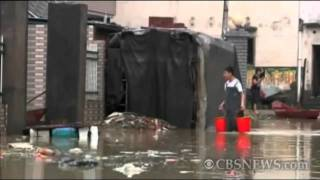 Villagers return after China floods displace millions