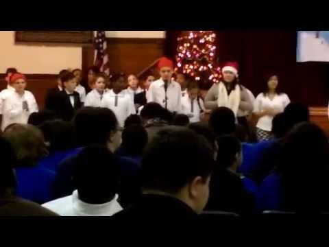 Phillip singing lil solo at Martin De Porres school concert