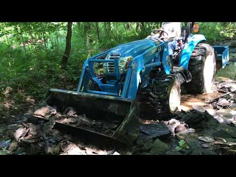 LS 4040 Tractor digging a swimming hole