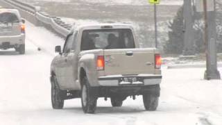 Snow challenges drivers on Barrow Road in Little Rock, AR